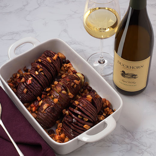 Hasselback Sweet potatoes with a glass of Duckhorn Chardonnay
