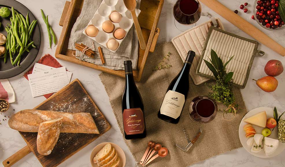 Pinot Noir bottles with food ingredients