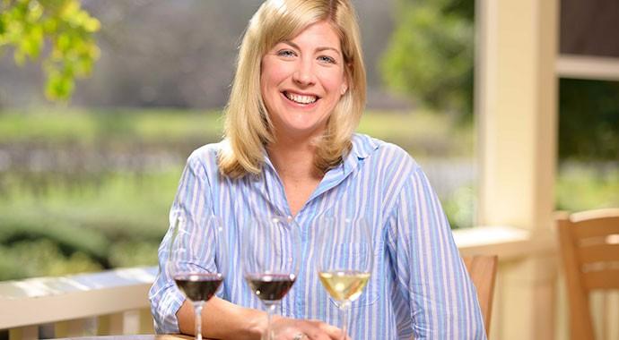 Winemaker Renee Ary walking through barrel cellar