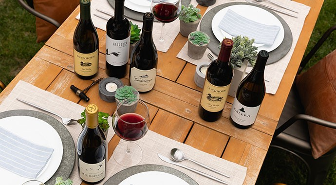 Duckhorn Portfolio wines on an outdoor table