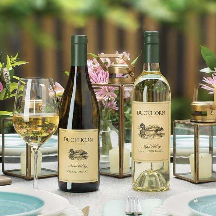 Duckhorn Sauvignon Blanc and Chardonnay on a table