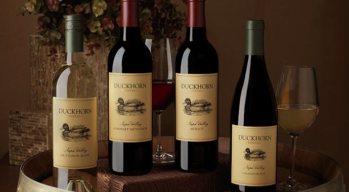 Four Duckhorn wines on a barrel
