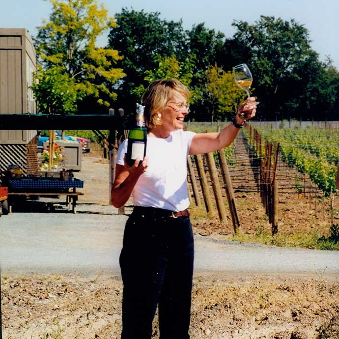 Margaret Duckhorn raising a glass upon building Duckhorn Estate house