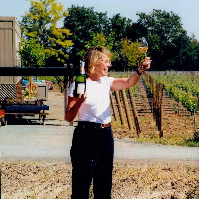 Margaret Duckhorn raising a glass upon building Duckhorn Estate house