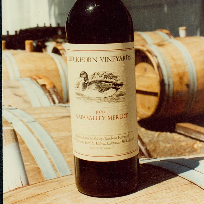 Original bottle of 1979 Duckhorn merlot on barrel