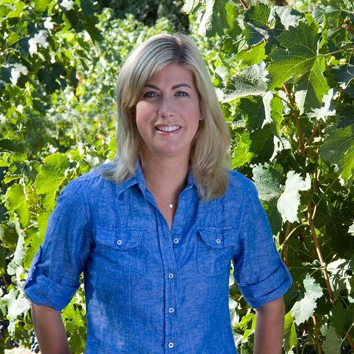 Winemaker Renee Ary standing in vineyards