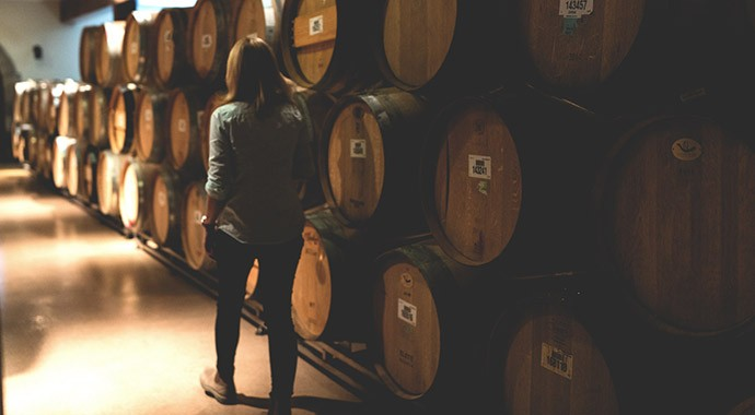 Winemaker Renee Ary walking through barrel cellar