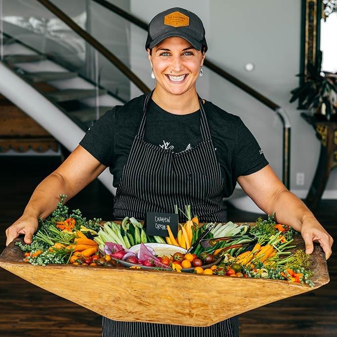 Chef Natalie Niksa of La Saison holding